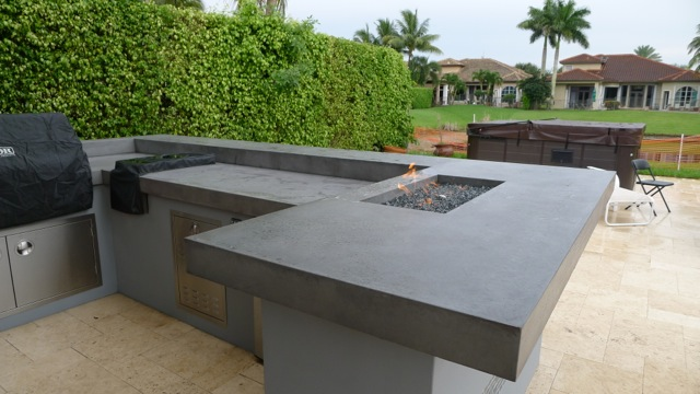 firepits built into concrete counter tops in outdoor